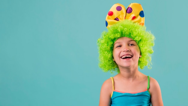 Portrait of little cute girl in clown costume with copy space