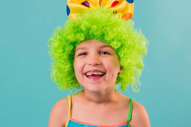 Portrait of little cute girl in clown costume