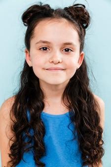 Portrait little girl on blue background