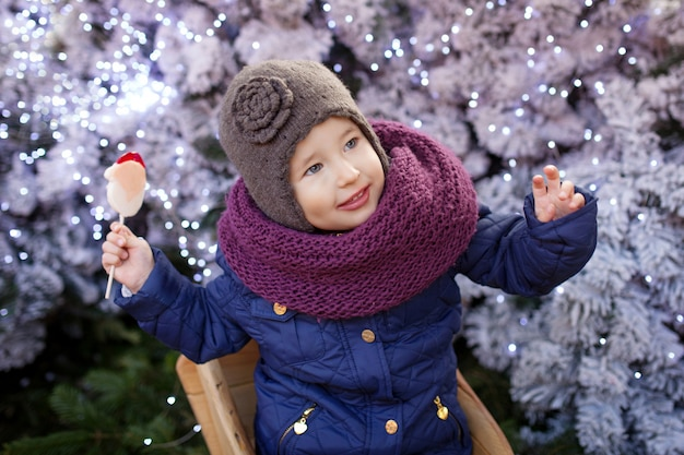 Portrait of little girl at christmas time outdoor.