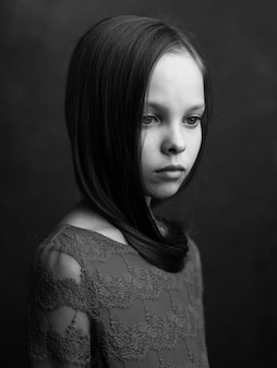 Portrait of a little girl closeup posing black and white photo
