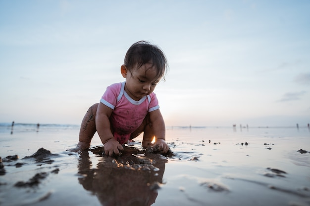 Portrait of a little girl enjoying playing a vacation on the beach