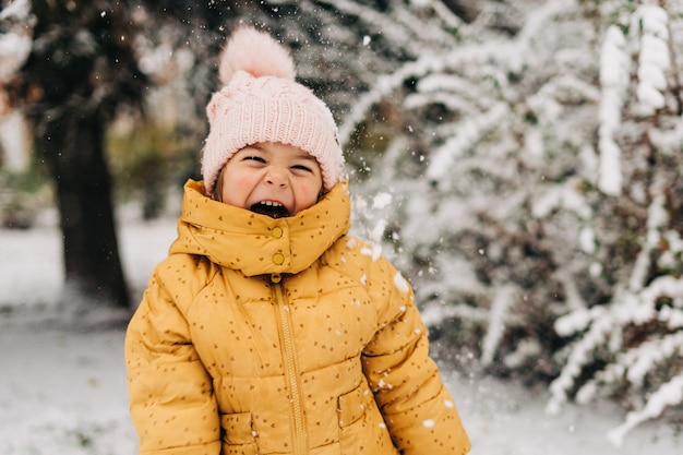 Portrait of a little girl happy to see snow