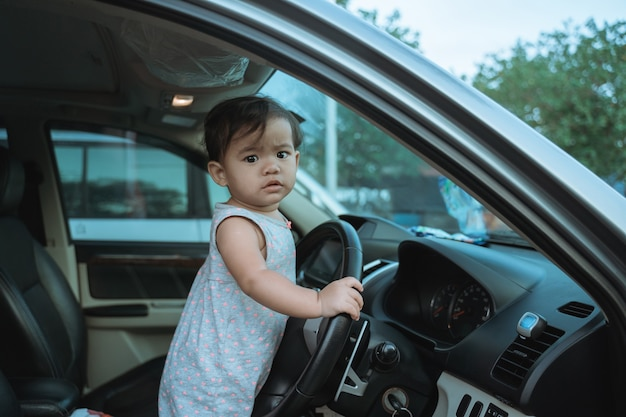 Portrait of little girl impatient on vacation by car