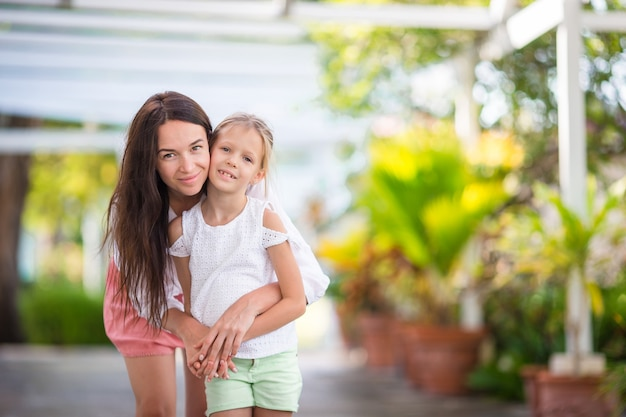 Portrait of little girl and mother on summer vacation