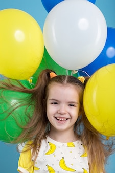 Portrait of little girl with baloons