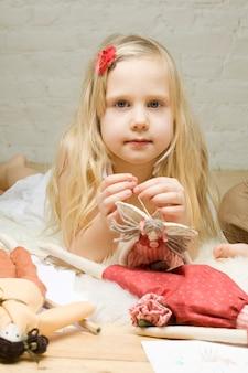 Portrait little girl with handmade toys