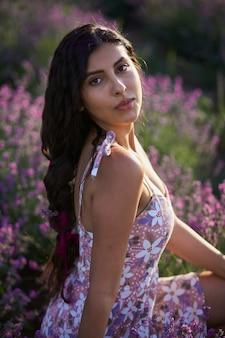Portrait of lovely brunette girl on lavender field background.