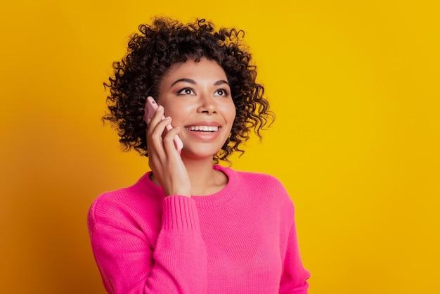 Portrait of lovely cheerful girl holding telephone make call speak listen communicate