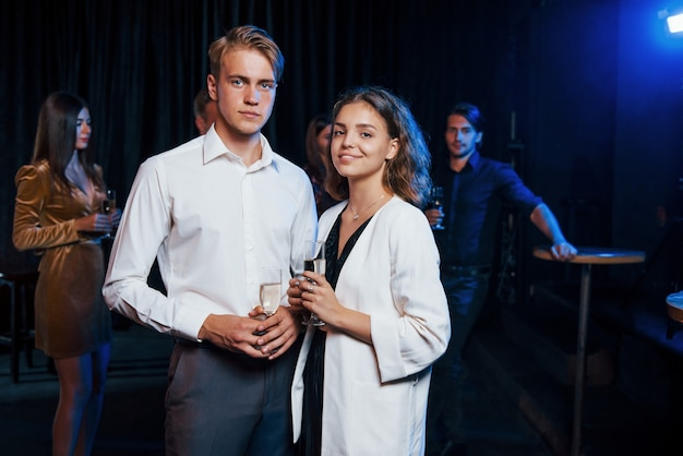 Portrait of lovely couple have party together with their friends.