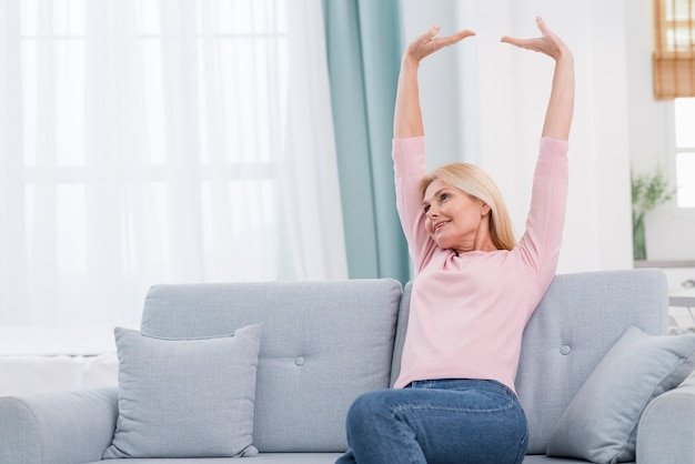 Portrait of lovely mature woman stretching
