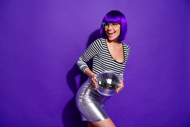 Portrait of lovely millennial screaming holding mirror ball dressed eyewear eyeglasses isolated over purple violet background