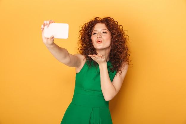 Portrait of a lovely redhead woman in dress