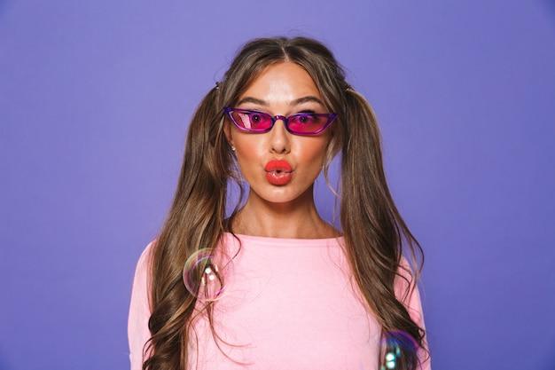 Portrait of a lovely woman in sweatshirt in sunglasses