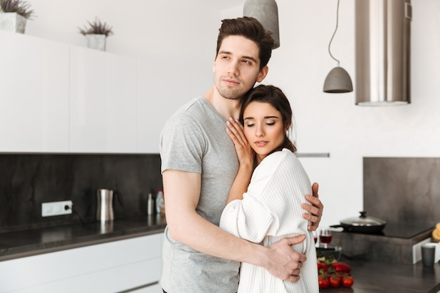 Portrait of a loving young couple hugging