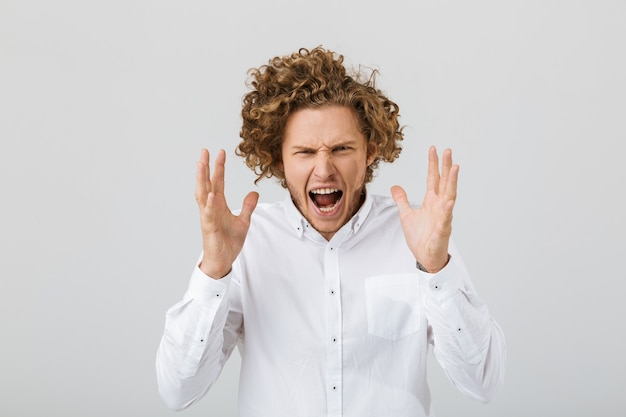 Portrait of a mad young man with curly hair