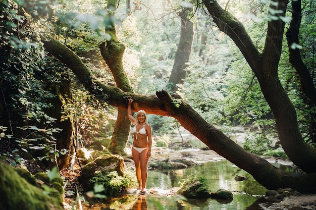 Portrait of a magnificent sexy woman in a bikini among the rainforest. makeup, cosmetics. beauty, fashion. spa, healthcare. tropical vacation.