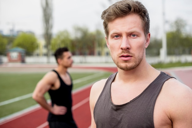 Portrait of a male athlete looking at camera