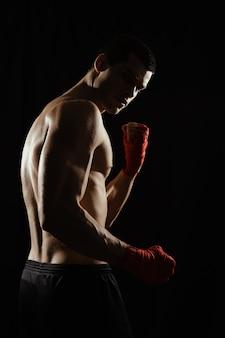 Portrait of male boxer looking over shoulder