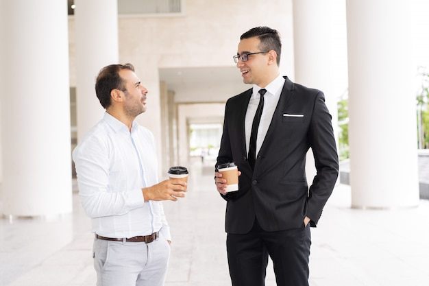 Portrait of male business colleagues drinking coffee and talking
