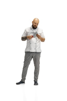 Portrait of a male chef cook isolated on white