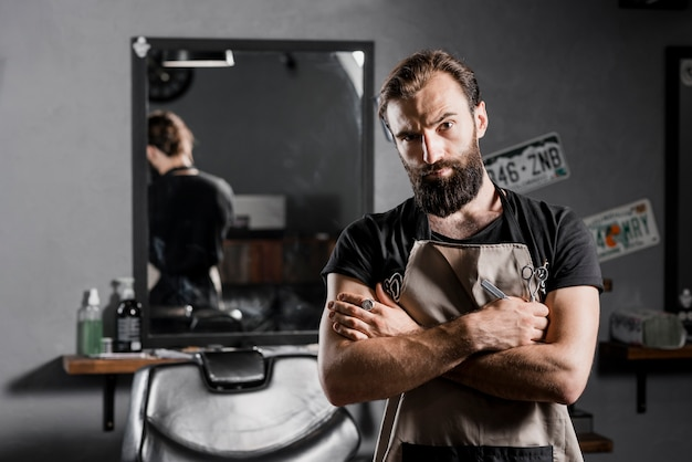 Portrait of a male hairstylist looking at camera