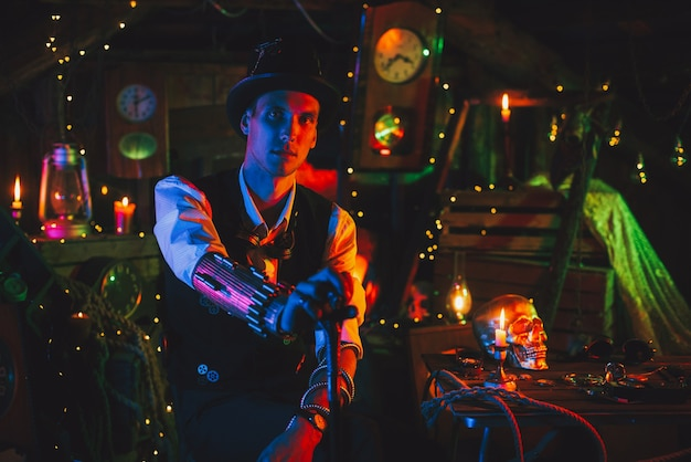 Portrait of male inventor in a steampunk suit, a top hat with a cane in hand sits in a watch workshop with neon light. cyberpunk cosplay