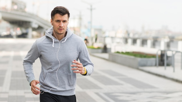Portrait of male running outdoors