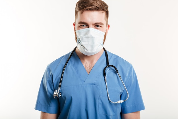 Portrait of a male surgeon wearing stethoscope and mask