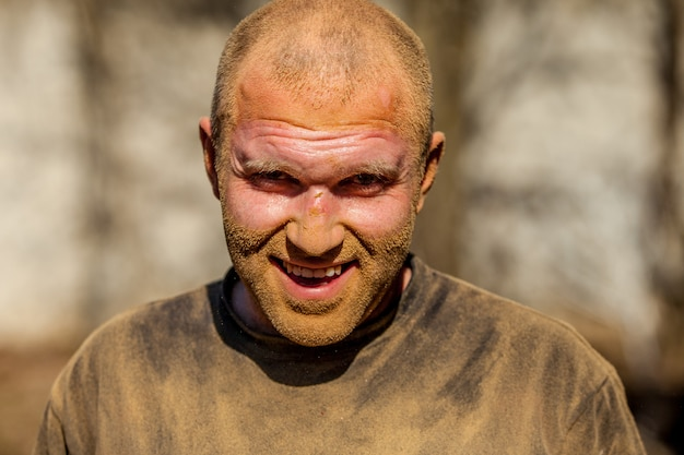 Portrait of a man 30 years old working dirty face in sweat