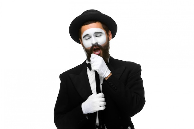 Portrait of a man as mime with tube or retro style microphone