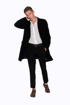 Portrait of a man in a black coat and trousers on a white background