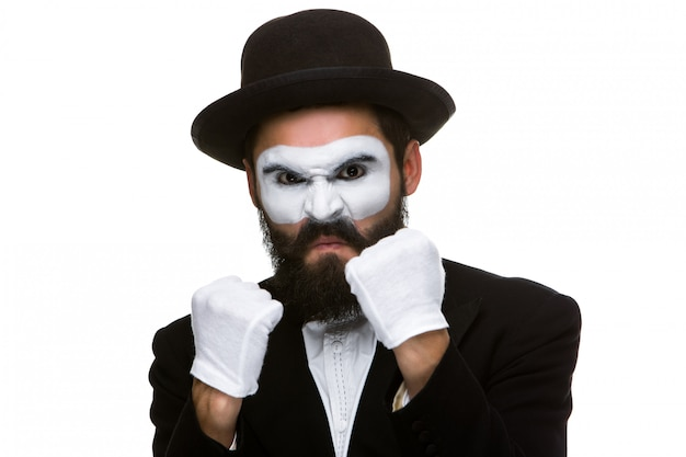 Portrait of a man boxing in makeup mime