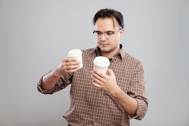 Portrait of a man choosing cup of coffee