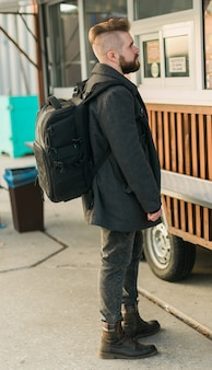 Portrait of man choosing fast food in food truck in the street. meal, food industry and streetfood concept.