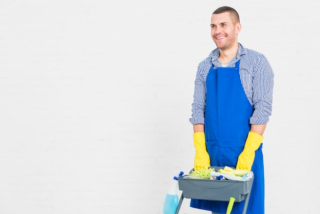 Portrait of man cleaning his home