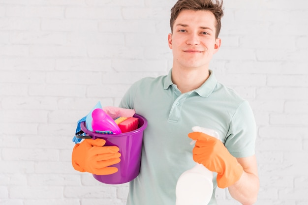 Portrait of man cleaning his house