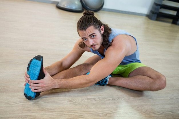 Portrait of man doing stretching exercise