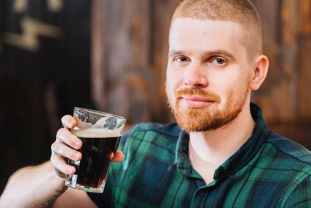 Portrait of a man drinking rum