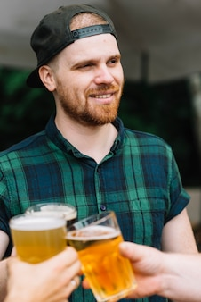 Portrait of a man enjoying beer with his friends