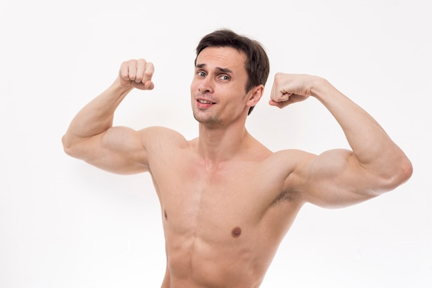 Portrait of man flexing arms