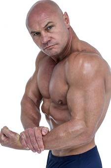 Portrait of man flexing muscles