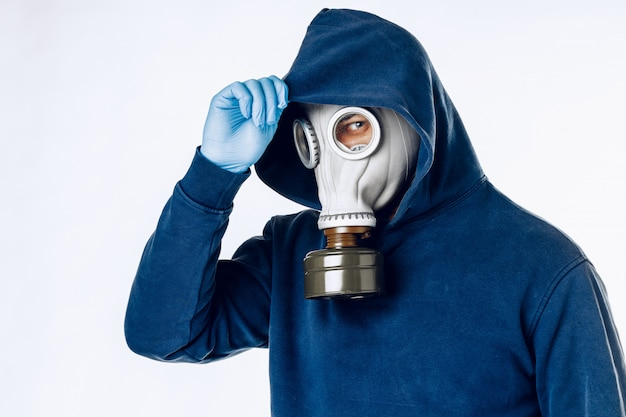 Portrait of a man in a gas mask. panic during quarantine. coronavirus pandemia concept