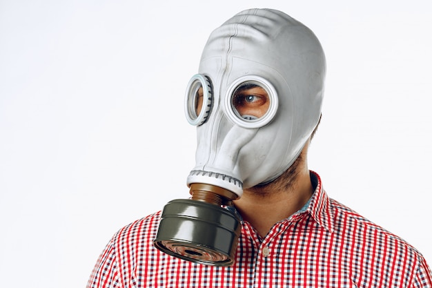 Portrait of a man in a gas mask.