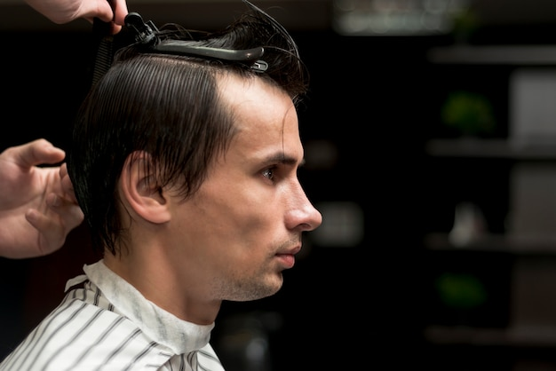 Portrait of a man getting a haircut