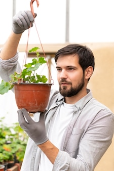 Portrait man growing plants