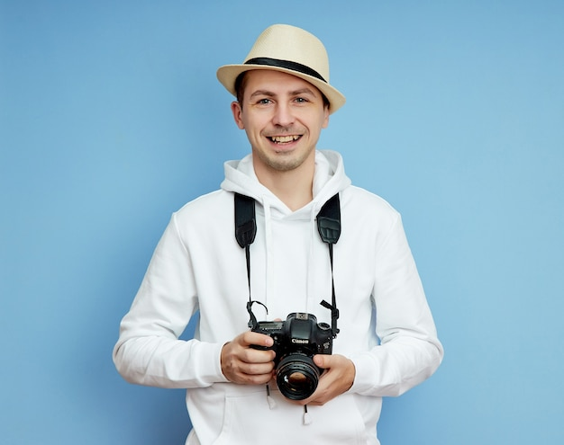 Portrait of a man in a hat, smile and cheerful emotions on his face