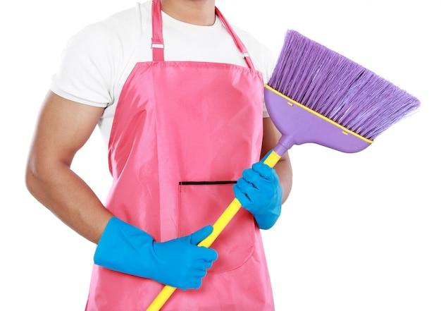 Portrait of man holding broom
