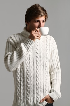 Portrait of man holding a cup of coffee