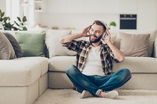 Portrait man at home listening music